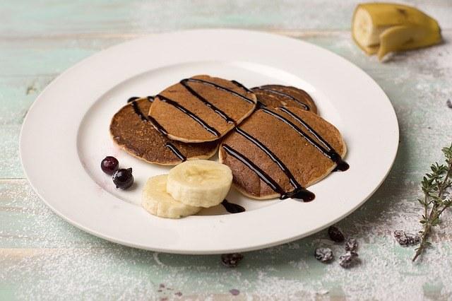 Hash Brown Pancake With Banana And Chocolate Syrup
